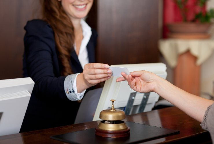 Women checking in at hotel